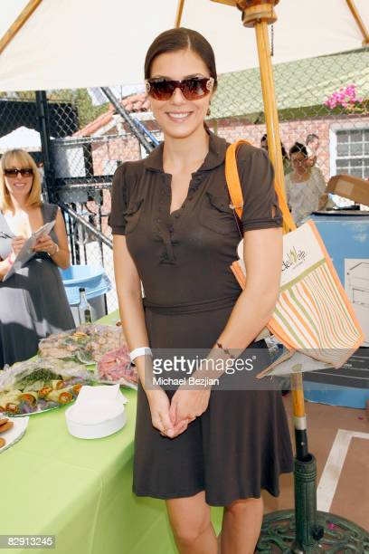 Model Adrianne Curry attends Debbie Durkin's Main Event Red Carpet Lounge and Green Suite Day 1 on September 18 2008 in Los Angeles California