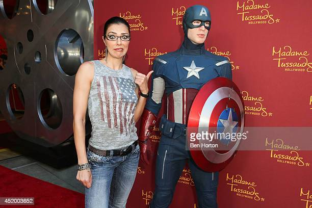 Model Adrianne Curry attends Madame Tussauds Hollywood grand opening party for the all new MARVEL 4D Theater Experience on July 10 2014 in Hollywood...