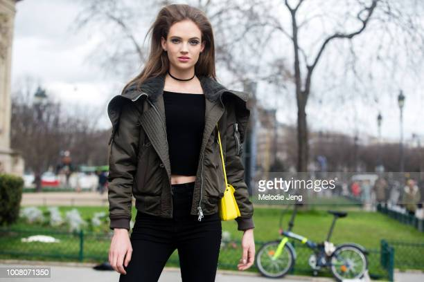 Model Adrienne Jueliger in big hair spiderlash makeup a green jacket after the Chanel show at Grand Palais during Paris Fashion Week Fall/Winter 2017...