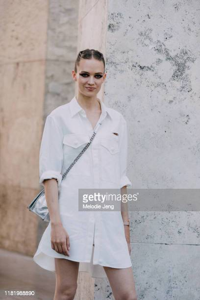 Model Adrienne Jueliger wears a white shirt dress after the Elie Saab show during Couture Fashion Week Fall/Winter 2019 on July 03, 2019 in Paris,...