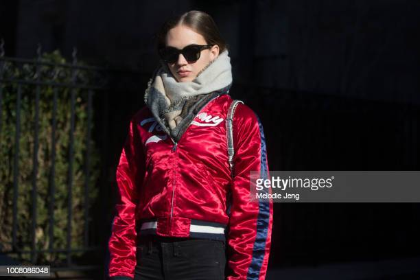 Model Adrienne Juliger wears a red Tommy Hilfiger varsity jacket on Day 6 of New York Fashion Week Fall/Winter 2017 on February 14 2017 in New York...