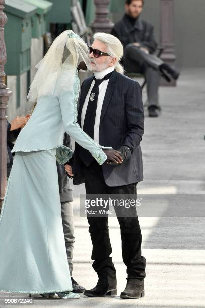 Model Adut Akech and Fashion designer Karl Lagerfeld kiss on the runway during the Chanel Haute Couture Fall Winter 2018/2019 show as part of Paris...