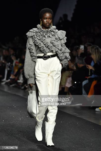 Model Adut Akech presents a creation during the Alberta Ferretti women's Fall/Winter 2019/2020 collection fashion show on February 20 2019 in Milan