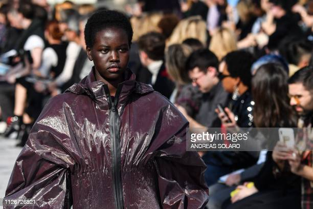 Model Adut Akech presents a creation during the Bottega Veneta women's Fall/Winter 2019/2020 collection fashion show on February 22 2019 in Milan