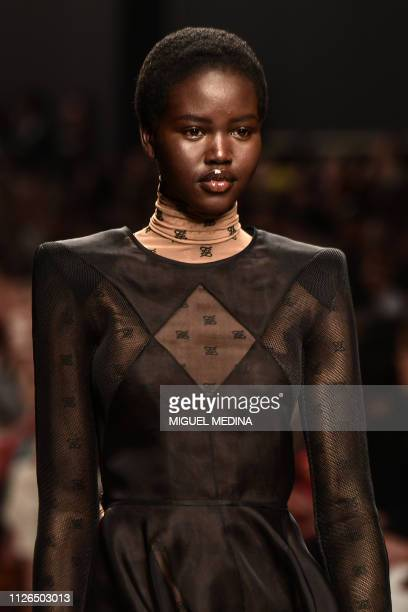 Model Adut Akech presents a creation during the Fendi women's Fall/Winter 2019/2020 collection fashion show on February 21 2019 in Milan