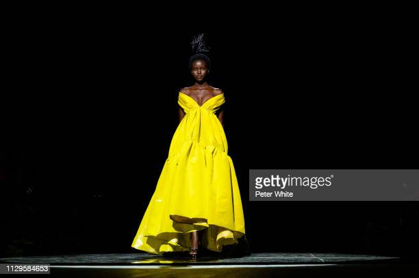 Model Adut Akech walks the runway at the Marc Jacobs fashion show during New York Fashion Week on February 13 2019 in New York City