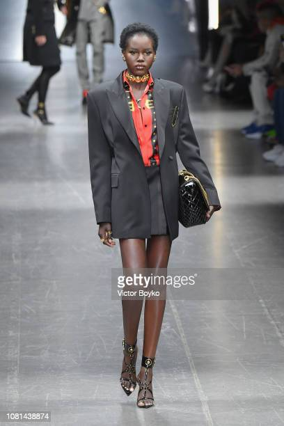 Model Adut Akech walks the runway at the Versace show during Milan Menswear Fashion Week Autumn/Winter 2019/20 on January 12 2019 in Milan Italy