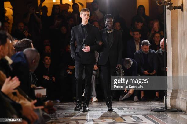 Model Adut Akech walks the runway during the Berluti Menswear Fall/Winter 20192020 show as part of Paris Fashion Week on January 18 2019 in Paris...