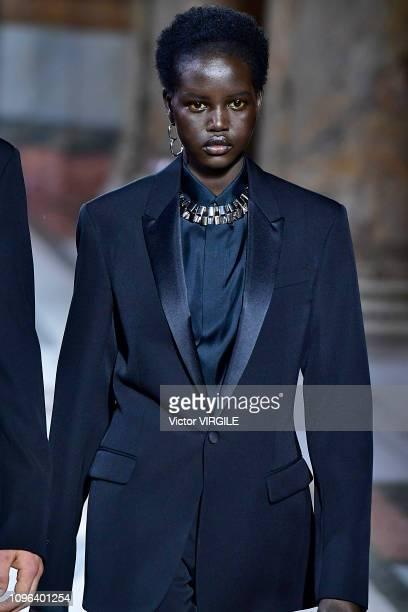 Model Adut Akech walks the runway during the Berluti Menswear Fall/Winter 20192020 fashion show as part of Paris Fashion Week on January 18 2019 in...