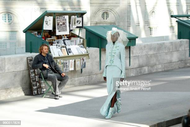 Model Adut Akech walks the runway during the Chanel Haute Couture Fall Winter 2018/2019 show as part of Paris Fashion Week on July 3 2018 in Paris...