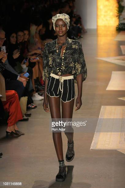 Model Adut Akech walks the runway for Anna Sui during New York Fashion Week The Shows at Gallery I at Spring Studios on September 10 2018 in New York...