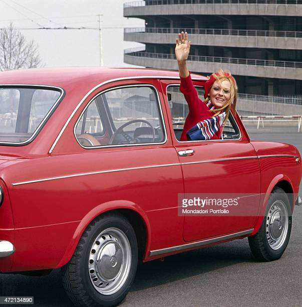 Model advertising a new model of a car 1960s