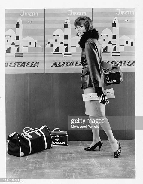A model advertising an Alitalia flight to Iran one of the prizes for the Christmas contest held by the magazine Grazia 1962
