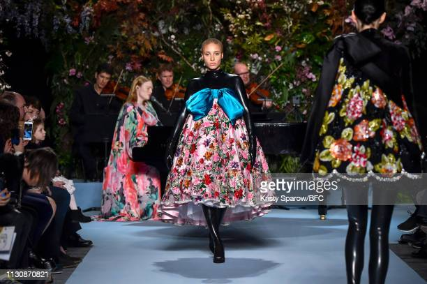 Model, Adwoa Aboah and Singer, Freya Ridings are seen on the runway during the Richard Quinn show during London Fashion Week February 2019 at Ambika...