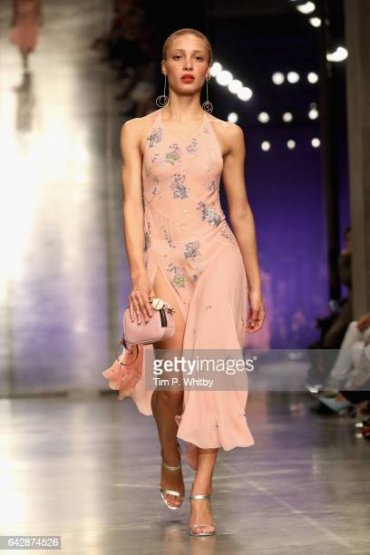 Model Adwoa Aboah walks the runway at the Topshop Unique show during the London Fashion Week February 2017 collections on February 19 2017 in London...