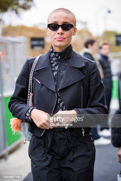 A model Adwoa Aboah wearing a black jumpsuit and black jacket is seen after the Chanel show on October 2 2018 in Paris France