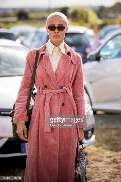 Model Adwoa Aboah wearing pink trench coat is seen after the Christian Dior show on September 24 2018 in Paris France