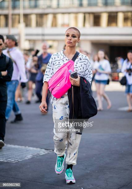 Model Adwoa Aboah wearing white button shirt with Playboy print Nike pants pink Prada belt bag sneakers seen outside Fendi Couture on day four during...
