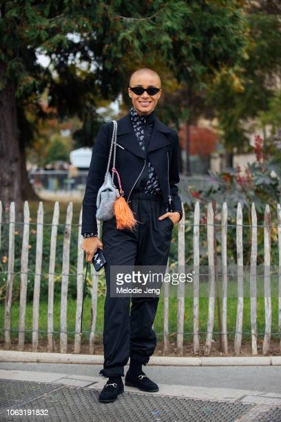 Model Adwoa Aboah wears a Saks Potts top after the Chanel show during Paris Fashion Week Spring/Summer 2019 on October 2 2018 in Paris France