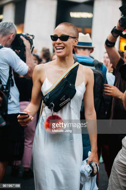Model Adwoa Aboah wears black sunglasses a tooth accessory a Prada fanny pack with a Brutalist pin a Fendi fur charm and a slip dress on July 05 2017...