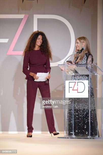 Model Afef Jnifen and founder of Fashion 4 Development Evie Evangelou speak onstage during Fashion 4 Development's 7th Annual First Ladies Luncheon...
