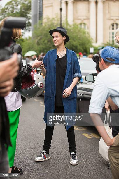 Model Agathe Mougin in Saint Laurent sneakers after attending Giambattista Valli on Day 2 of Paris Haute Couture Fashion Week Autumn/Winter 2014 on...