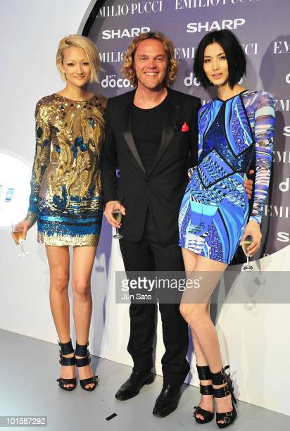 Model Ai Tominaga designer Peter Dundas and model Miyuki Koizumi attend Emilio Pucci 201011 A/W Collection at Ebisu Garden Place on June 3 2010 in...