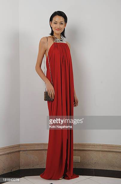Model Ai Tominaga poses for photographs during the Michael Kors Celebration of American Fashion at the US Ambassadors Residence on November 5 2011 in...