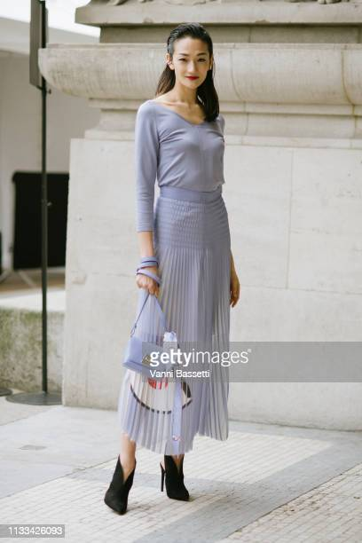 Model Ai Tominaga poses wearing Akris after the Akris show at the Grand Palais during Paris Fashion Week Womenswear Fall Winter 1920 on March 03 2019...