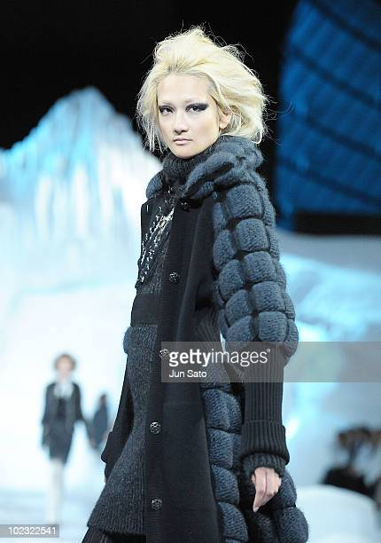 Model Ai Tominaga walks the runway during the Chanel 20102011 Fall/Winter PretAPorter collection show at Yoyogi National Gymnasium on June 23 2010 in...