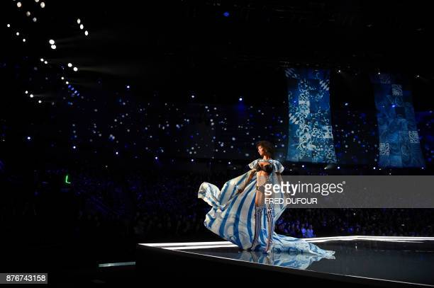 US model Aiden Curtiss presents a creation during the 2017 Victoria's Secret Fashion Show in Shanghai on November 20 2017 / AFP PHOTO / FRED DUFOUR /...