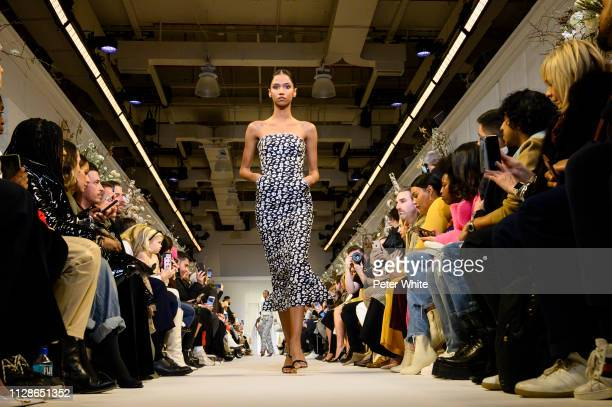 Model Aiden Curtiss walks the runway at the Brandon Maxwell fashion show during New York Fashion Week on February 09 2019 in New York City