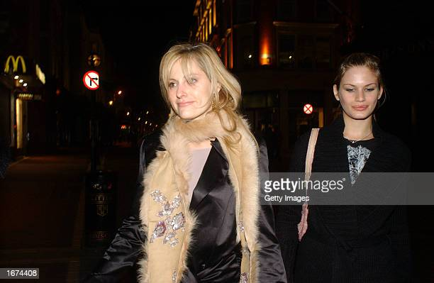 Model Aimee Mullins and Swedish model Vicky Andren walk to the Trilogy after party in Lillies Bordello on Grafton Street December 5 2002 in Dublin...