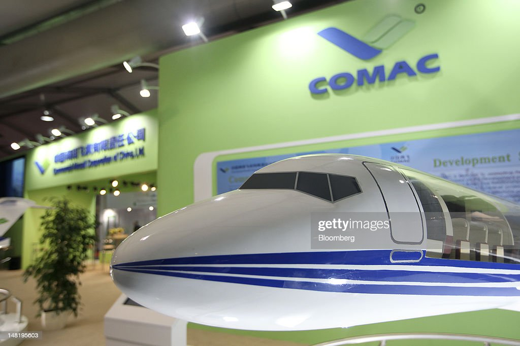 A model aircraft sits on display at the Commercial Aircraft Corp. of China (Comac) stand on the third day of the Farnborough International Air Show in Farnborough, U.K., on Wednesday, July 11, 2012. The Farnborough International Air Show runs from July 9-15. Photographer: Chris Ratcliffe/Bloomberg via Getty Images