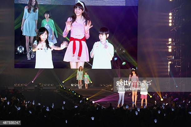 Model Airi Matsui who is from Fukushima prefecture walks on the runway with elementary school pupils during the Tokyo Girls Collection hedl at Big...