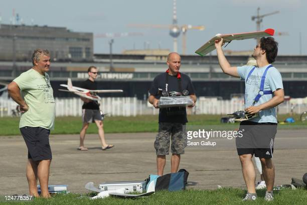 Model airplane enthusiasts launch their remotecontrolled airplanes at former Tempelhof airport on September 11 2011 in Berlin Germany Tempelhof...
