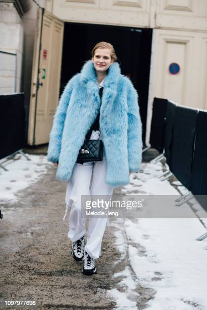 Model Aivita Muze wears a baby blue fur coat black purse white jeans and Fila sneakers after the Chanel show during Couture Fashion Week...