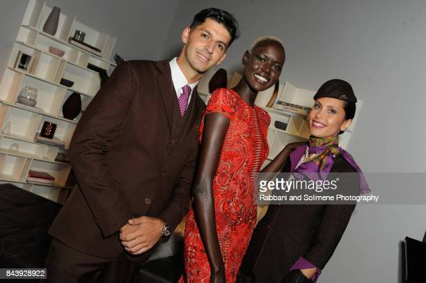 Model Ajak Deng and flight attendants attend Etihad Airways Celebrating Runway To Runway With Special Guest Julien MacDonald Obe at Skylight Clarkson...