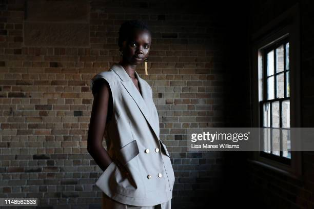 Model Akiima poses backstage ahead of the Mercedes-Benz Presents Aje show at Mercedes-Benz Fashion Week Resort 20 Collections at Campbell's Stores on...