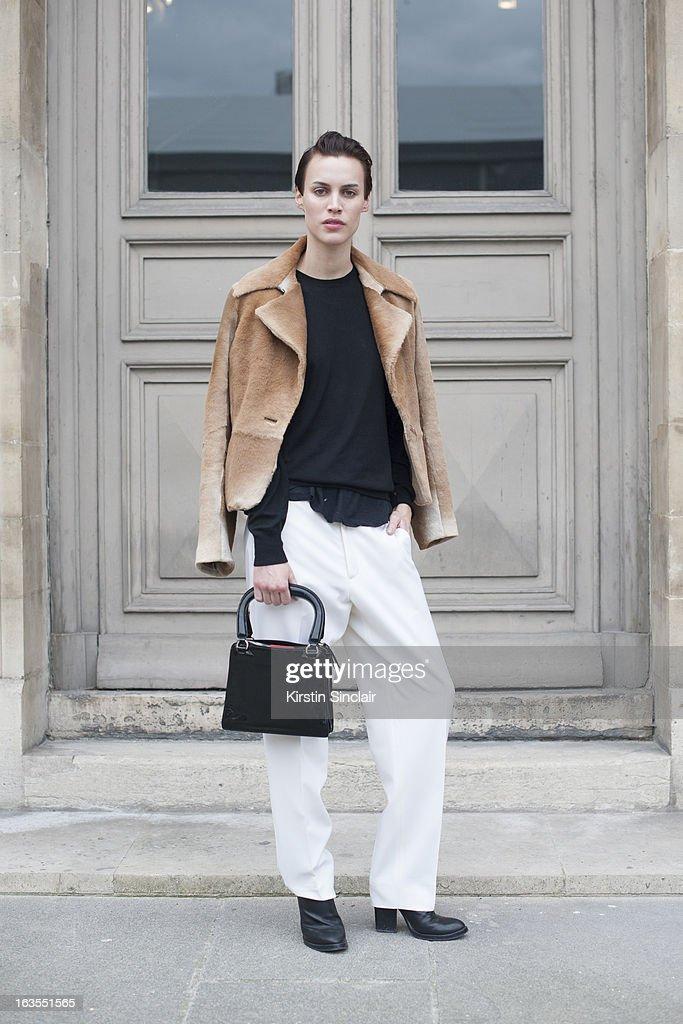 Model Alana Bunte wears Black Denim trousers, Versace sweater, Max Mara jacket, Miu Miu bag and Haider Ackermann shoes on day 7 of Paris Womens Fashion Week Autumn/Winter 2013 on March 06, 2013 in Paris, France.