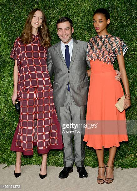 Model Alana Zimmer, designer and finalist Chris Gelinas of CG, and Aya Jones attend the 12th annual CFDA/Vogue Fashion Fund Awards at Spring Studios...