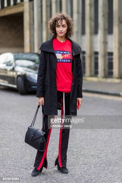 Model Alanna Arrington wearing a red Tommy Hilfiger tshirt jogger pants outside Topshop Unique on day 3 of the London Fashion Week February 2017...