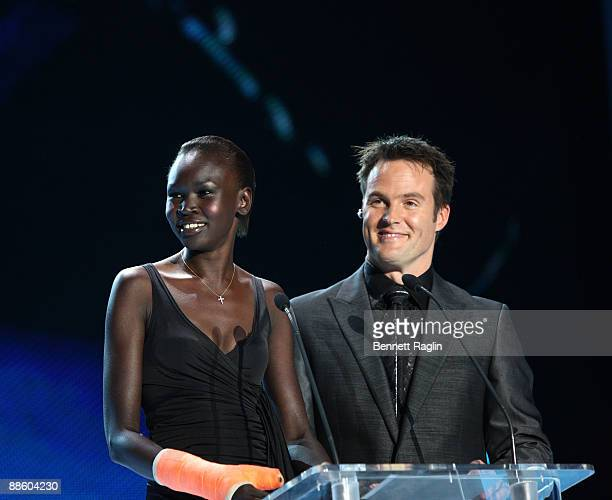 Model Alek Wek and TV personality Michael Mol ARISE Africa Fashion Awards>> at Sandton Convention Center on June 20, 2009 in Johannesburg, South...