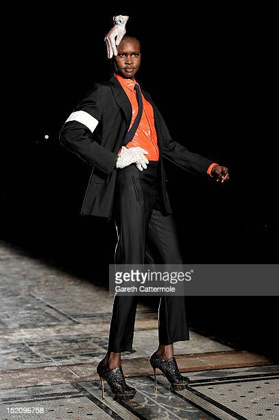 Model Alek Wek showcases designs on the catwalk by Philip Treacy on day 3 of London Fashion Week Spring/Summer 2013, at The Royal Courts Of Justice...