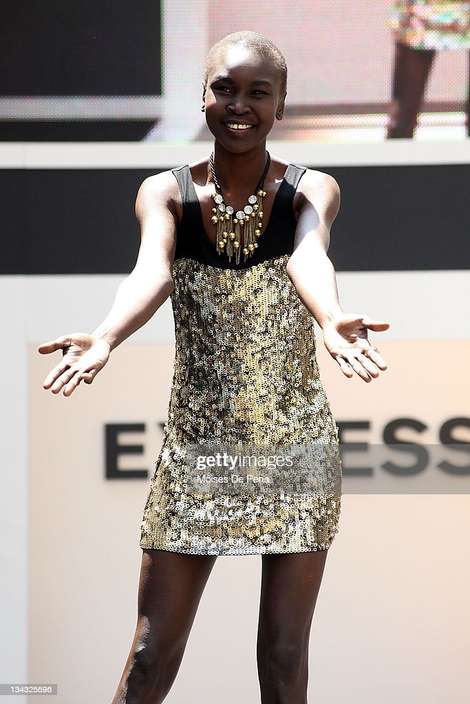 Model Alek Wek walks the catwalk during the Express 30th Anniversary Celebration Fashion Show outside of the New York Stock Exchange on May 14, 2010 in New York City.