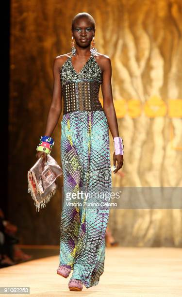 Model Alek Wek walks the runway at the Miss Bikini Luxe Fashion Show during the Milan Fashion Week Spring/Summer 2010 at Milano Fashion Center on...