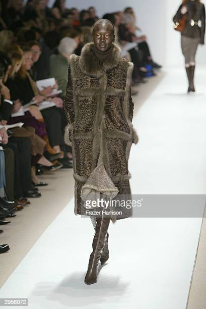 Model Alek Wek walks the runway at the Oscar De La Renta fashion show during Olympus Fashion Week at Bryant Park February 9 2004 in New York City
