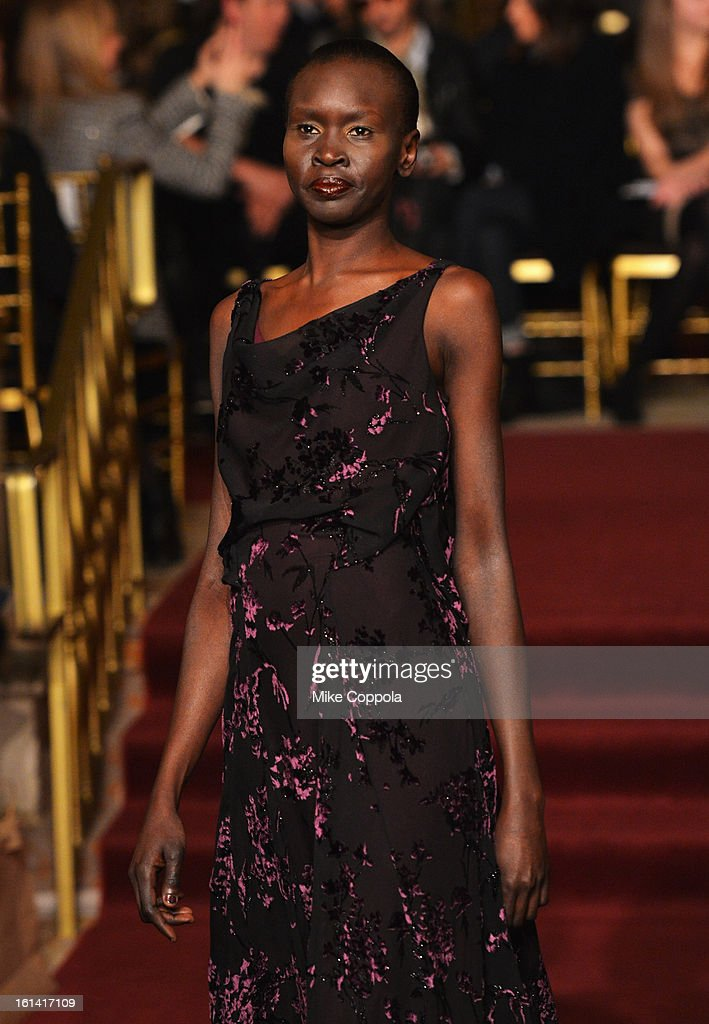 Model Alek Wek walks the runway at the Zac Posen Fall 2013 fashion show during Mercedes-Benz Fashion Week on February 10, 2013 in New York City.