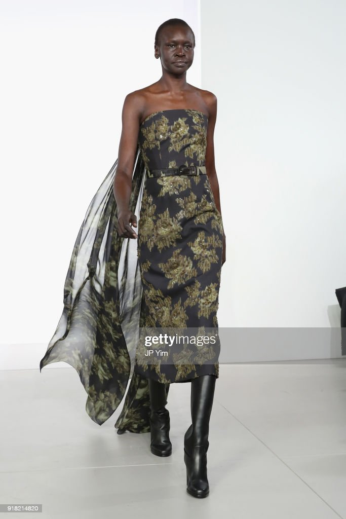Model Alek Wek walks the runway during the Michael Kors Collection Fall 2018 Runway Show at Vivian Beaumont Theatre at Lincoln Center on February 14, 2018 in New York City.