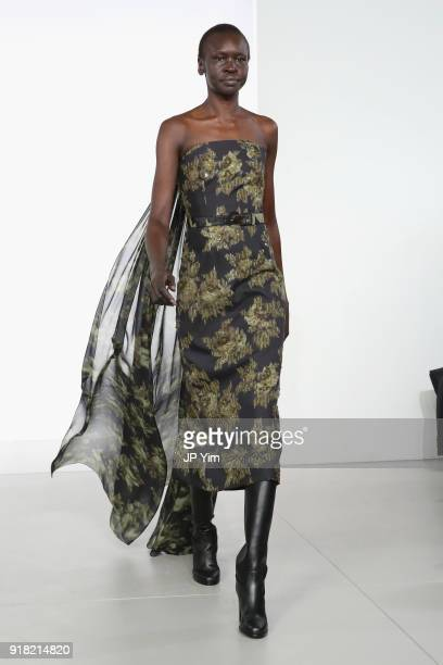 Model Alek Wek walks the runway during the Michael Kors Collection Fall 2018 Runway Show at Vivian Beaumont Theatre at Lincoln Center on February 14...